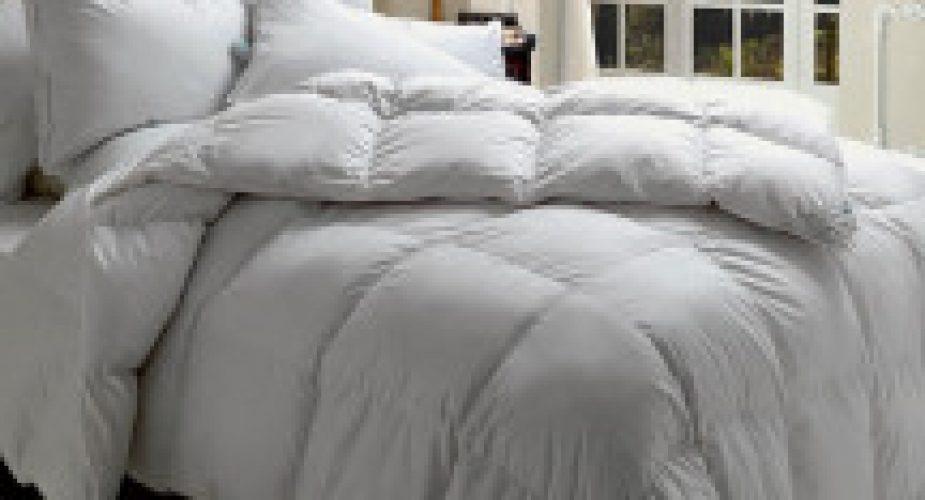 camera-da-letto-classica-con-piumino-216×300